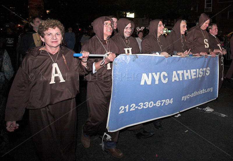 Not quite sure why Athiests would be wearing Monk outfits??? New York City Halloween Parade, 2006.