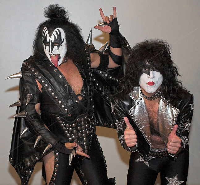 <h2>Too bad these guys are camera shy. New York City Halloween Parade, 2006. The REAL Kiss posing for me.  Gene Simmons and Paul Stanley.  Glad I got the shot.