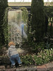 Hicks Nursery, Westbury New York <h2>Youngster looking at man-made waterfall and pond. This image printed in Newsday 3/14/2012  (Page A-20)