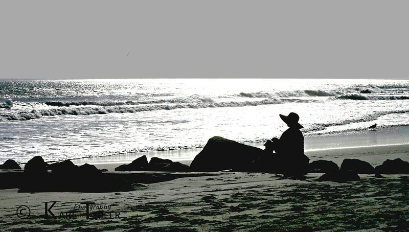 Contemplating as the sun sets over the Atlantic Ocean.