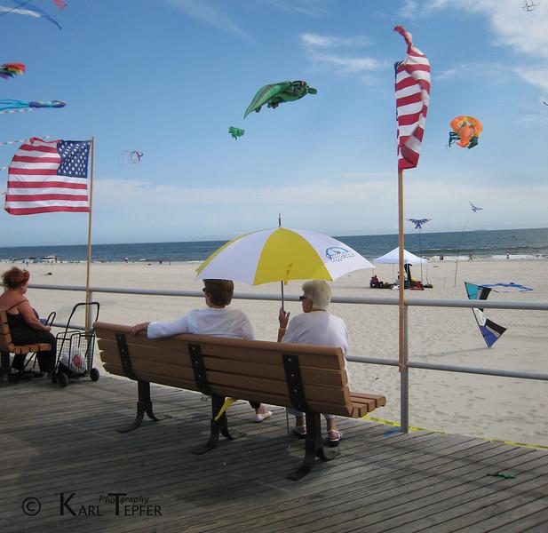 Flags, kites, umbrella, beach, ocean...