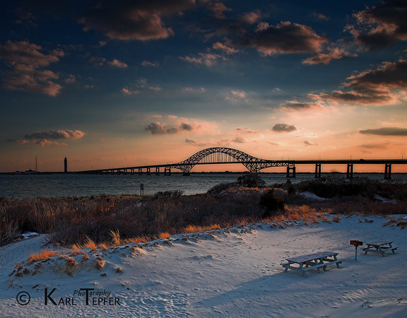 Sunset over Great South Bay and Robert Moses Bridge.  FREEZING/Windy day in the snow. Seascape