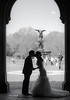 Bride and Groom....silhouette being watched over by the Angel of the Waters Statue at Bethesda Fountain, Central Park,  NYC.