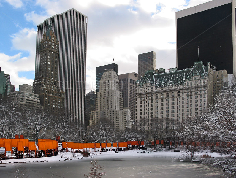 Central Park, Manhattan, New York City in the winter. Plaza Hotel in the background.  The Gates