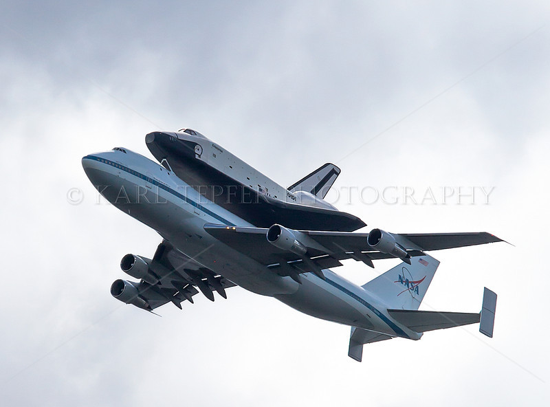 "The Space Shuttle Enterprise on the Final Mission.   This shot was taken as it passed directly over the Statue of Liberty on 4/27/2012. (Should have used a wider angle lens for the ""iconic"" image I wanted)"