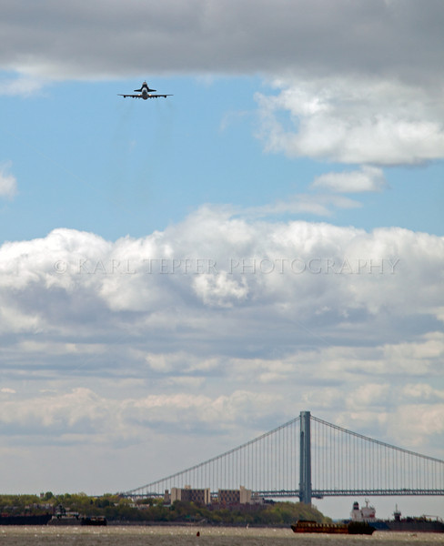 Final approach of Space Shuttle towards New York City as it passes over the Verrazano Bridge. The huge crowd began cheering as we all realized what we were seeing approaching from the distance.   It was quite a sight to see the duo passing over the bridge heading our way.