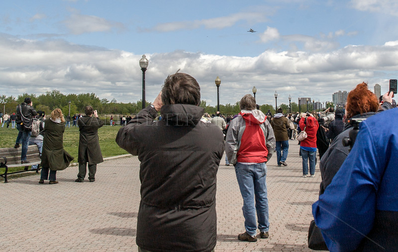 Part of the huge crowd at Liberty State Park, New Jersey taking photos, cheering and clapping as the Shuttle Enterprise made its final flight leading to JFK airport landing.