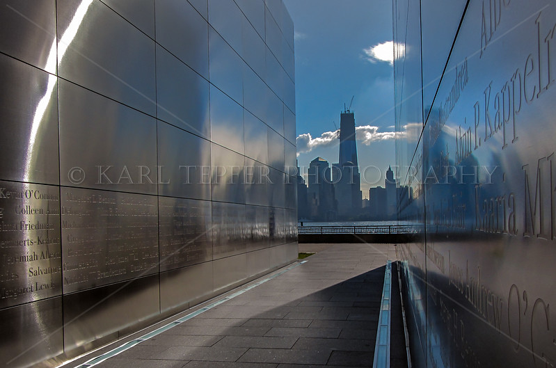 """Dawn at the """"Empty Sky"""" Memorial at Liberty State Park, New Jersey. 6/6/2012 The Freedom Tower is now the tallest building in Manhattan.  The names inscribed on the walls are those of residents who perished in the World Trade Center."""