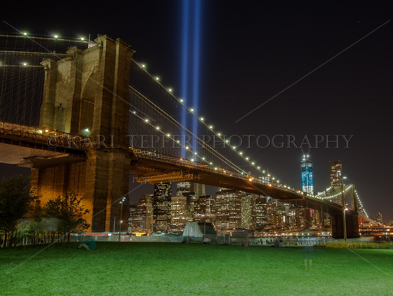 Light Tribute and Freedom Tower rising behind the Brooklyn Bridge 9/11/2012