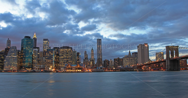 Lower Manhattan at Dusk. South Street Seaport, Woolworth Building, Brooklyn Bridge and, in distance, Ground Zero.