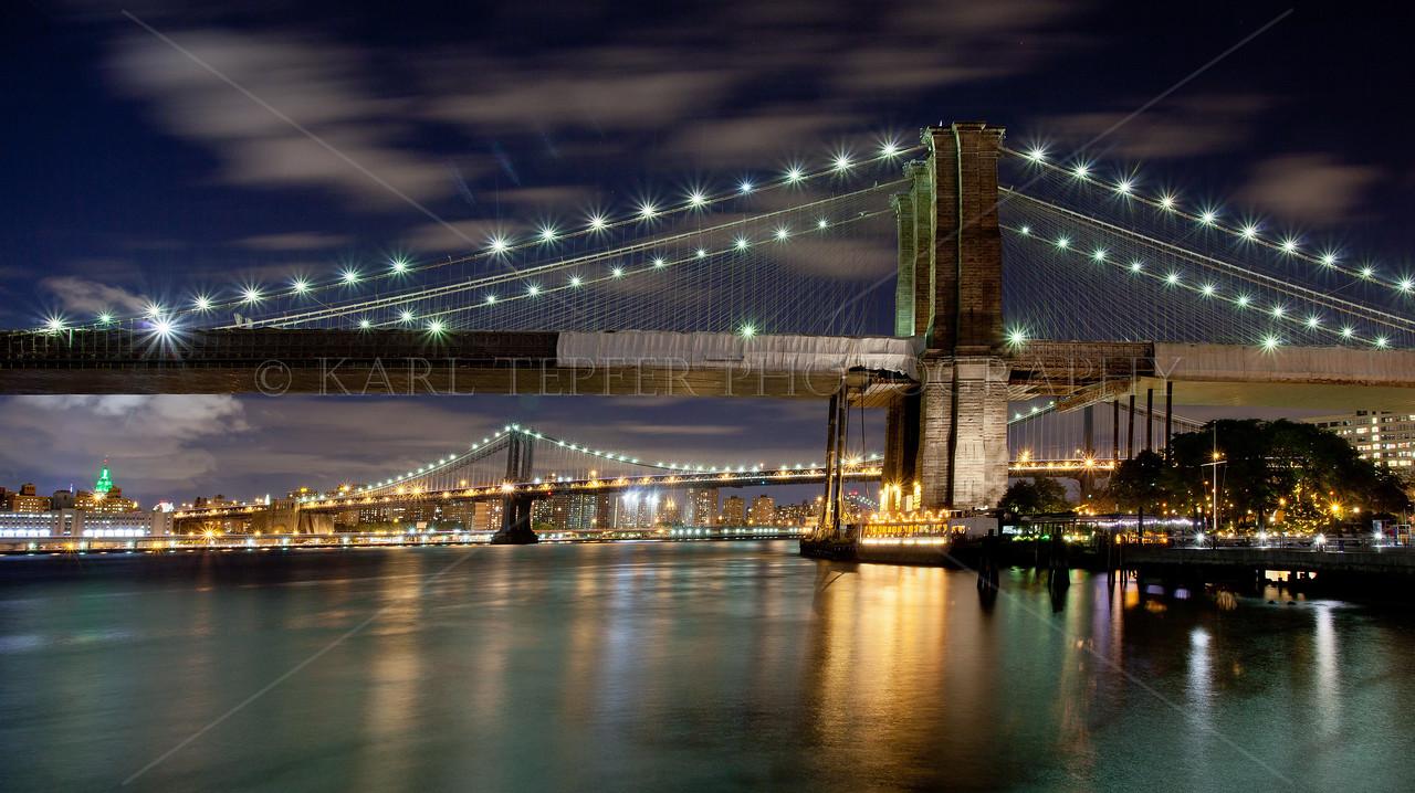 Brooklyn Bridge, Manhattan Bridge and green Empire State Building.