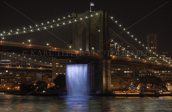 """View of the """"Waterfall"""" underneath the Brooklyn Bridge.  Created by artist Olafur Eliasson, there were a total of 5 Waterfalls around various portions of Lower Manhattan during the Summer and Fall of 2008. This was taken from the third floor of Pier 17 at the South Street Seaport."""