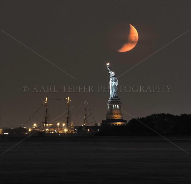 Statue of Liberty, Coast Guard training ship Eagle, and......the Moon. Taken from quite a distance but liked the overall composition.