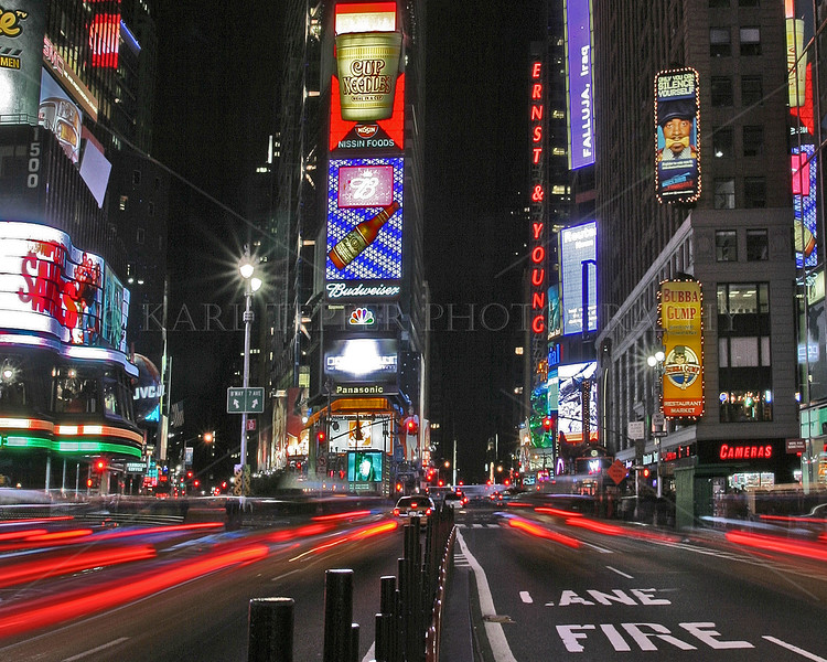 Times Square at night.  Risky taking this shot, but worth it.
