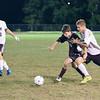 Alex Taylor-Lash defends ball