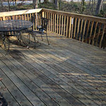 Deck off kitchen captures morning light, shaded in the afternoon.
