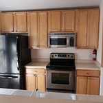 Kitchen with stainless/black appliances. All Energy Star.