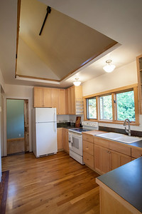 The opening into the upstairs loft gives the kitchen a spacious and open feeling.