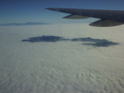 Departing SNA, this is what JUNE GLOOM looks like from above the clouds.  I believe that's the top of Catalina there.