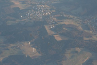 Germany is booming with wind power.  Clusters can be seen of the systems for miles in many directions.