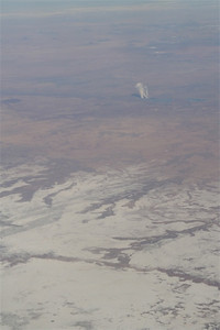 I believe this was over New Mexico.  The white in the forground is a mineral bed, the background plant is some kind of mystery operation.  Look at the next image, and if you know what it is - leave a comment please.