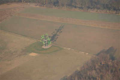 Sorry, blurry - but too curious to not keep this image.  Some type of art in a field, on approach to Frankfurt, Germany.