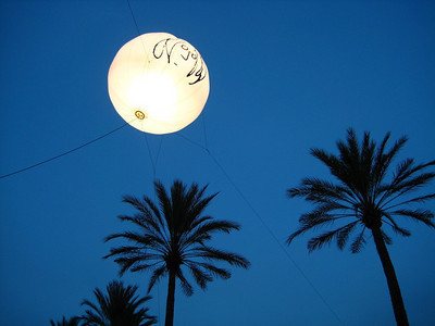 John Lennon lantern suspended between the trees of the outdoor area.