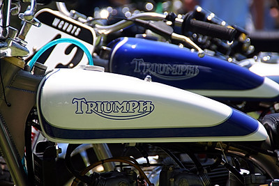 Motorcycles galore!  Here - opposite paint schemes on Triumph tanks.