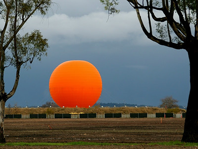 The brilliance of the orange balloon is not enhanced - even to the naked eye, it's just darn bright!