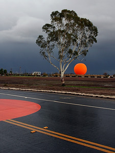Another composition of the balloon at the Great Park, here in the storm.