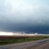 April 22, 2010<br /> <br /> The funnel on the left is what's left of the old wall cloud, and begins to spin rapidly. On the right of that is the new wall cloud and funnel poking down.
