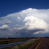 April 21, 2010<br /> <br /> Cleaned lens now. Still driving eastward nearing the town of Lockney. Absolute nuclear bomb of an updraft with over-shooting top.