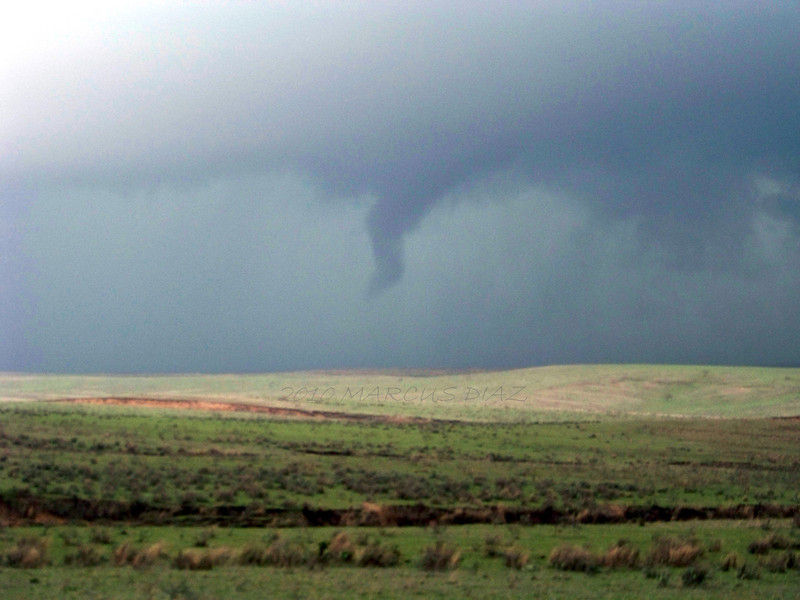 April 22, 2010<br /> <br /> After re-positioning north of Alanreed, the massive rotating meso begins to spit out small, brief tornadoes!