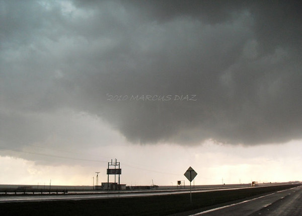 April 20, 2010<br /> <br /> 4 miles west of Bushland, looking west at this rapidly rotating cone funnel. Its strange...the entire base looks sloppy and there's no clear RFD cut from my angle...