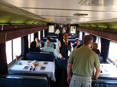 Sorry about the motion blur, but here's a good shot of the restaurant car.  Sleeper cabins have priority, and the meal is included!  That's William, our Amtrak food host for the trip.
