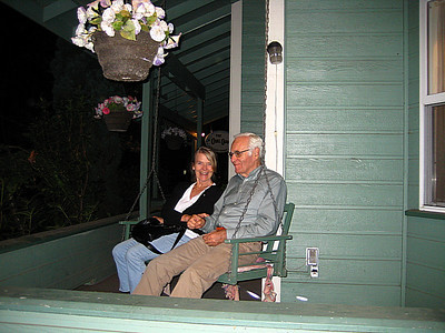 "After a pleasant evening out, our friends test out the front porch swing at our B&B, ""The Oval Door""!"