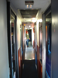Our cabin shares the community shower and toilets.  This is a view down the length of the downstairs of our railcar.