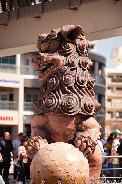 Shisa, the traditional Ryukyu decoration that looks like a cross between a lion and a dog. Often deployed in pairs on rooftops or at gates. Usually one with open mouth to scare off evil spirits and one with closed mouth to keep good spirits in.