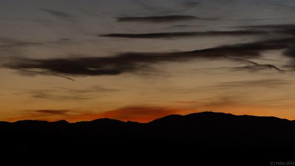 Sun setting behind the Rockies, Denver, Colorado.