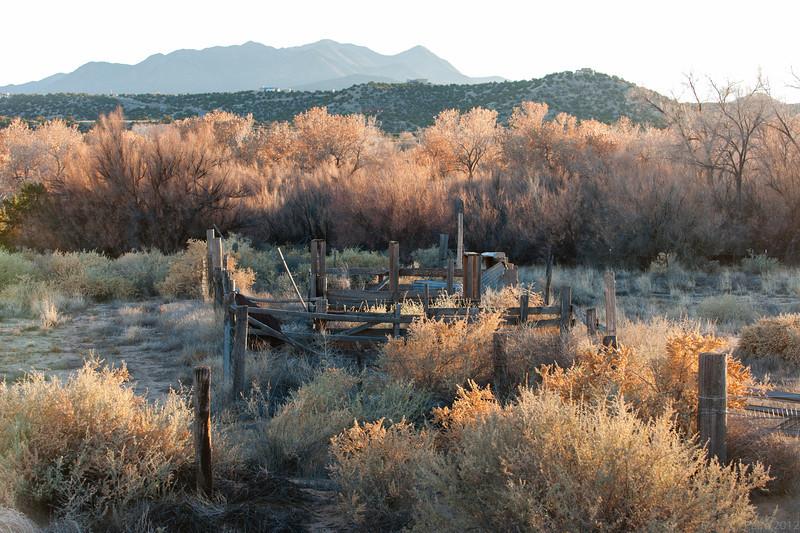 Sun setting along state road 14 outside Santa Fe, New Mexico.