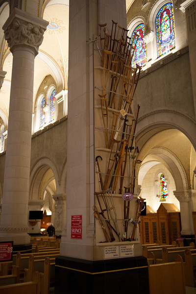 1 of 2 racks of crutches, canes, & braces of pilgrims reportedly cured in the bascilica