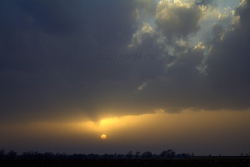 The sun would later disappear before reaching the horizon behind a distant wall of dirt.