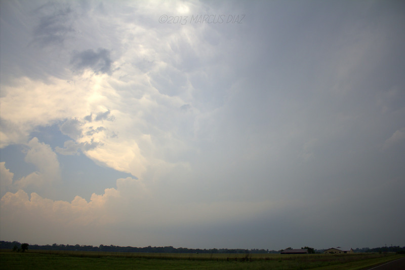 The tornado is back in there in the haze somewhere, just crossed I-44 heading for Moore.