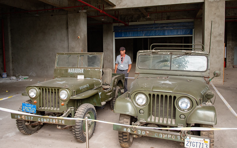 Bob checking out 2 vintage Army Jeeps