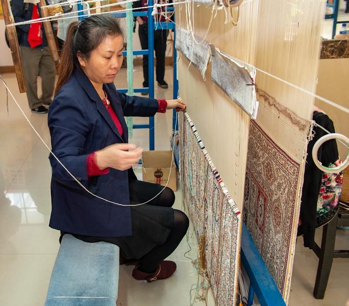 Silk rug weaving demo