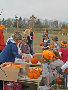 CP PumpkinFest OlympicsKidsGetPumpkins 102314 TS