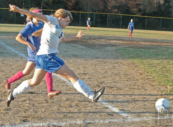 DIS; Soccer; Summner; AllisonEBootsit; 102314; DIS; Deer IsleStonington High School; GirlsSoccerSumner1014; Mariners; dishs; game; high school; school; soccer; sports; team Allyson Eaton boots the ball.