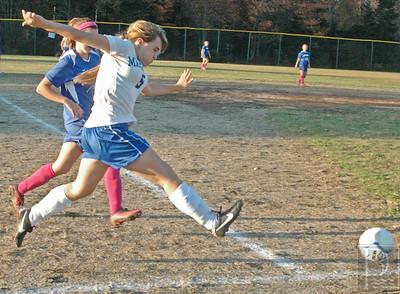 Allyson Eaton boots the ball