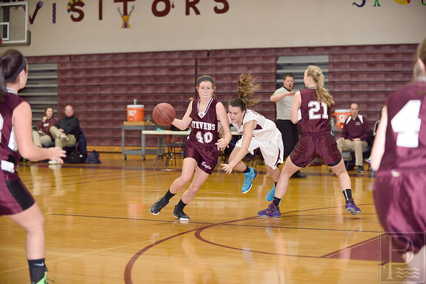 Sports; gsa; girls; scrimmage; EHS; Nov22; ALice; Dillon; 120414; Eagles; GSA; George Stevens Academy; basketball; game; high school; school; sport; sports; team Senior Alice Dillon crosses the Ellsworth defense. Photo by Franklin Brown