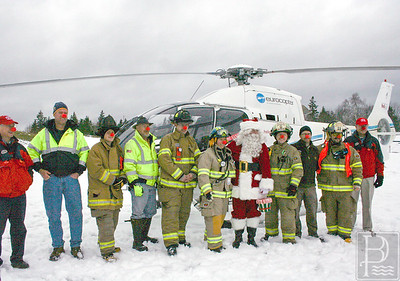 CP flying santa firefighters 120414 AB